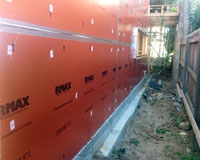 RMax ThermaAdvantage board being installed as thermally superior sisalation wrap.
