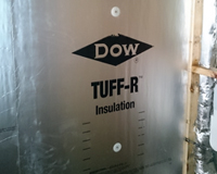Dow Tuff-R 25.4mm thermal insulation boards installed directly to block walls with Hilti fasteners.