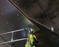 Kingspan Kooltherm K10 insulation board being fitted above car park ramp (off scaffolding). 11 fixings per board.