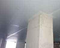 Dow Thermax PIR insulation board direct fixed to concrete slab – white face of board is visible.