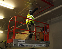 Using scissor lift to tape CSR Xtratherm boards at height.